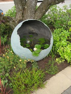 """""""Little and Lewis"""" water feature in Marie's Garden entry..cool idea looks like a very large egg that has broken open under a tree."""