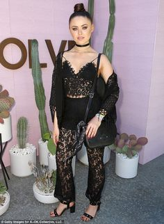 Dark hued ensemble: Kristina Bazan wore a black lacy top with matching bottoms and a fring...