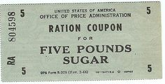 Another form of rationing that was employed during World War II, called Ration Stamps. Description from felavel.xlx.pl. I searched for this on bing.com/images