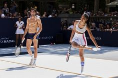 Models play tennis during an event to promote the launch of Tommy Hilfiger's new line of underwear, in New York August 25, 2015. REUTERS/Lucas Jackson