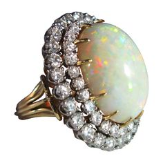 Superb Large Opal Cabochon Diamond Cocktail Ring  1960's  Superb large Cocktail ring, with fabulous quality Australian bold cabochon, with strong depth and fire, great protruding volume, with strong double diamond white gold bezel /