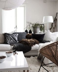 Neutral, white, comfy, cozy. Love the pillows and the shaggy area rug.