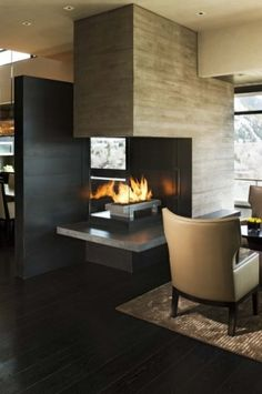3 way fireplace . Magnifico Residence by B & G design . the black wall creates a unique view through the fireplace
