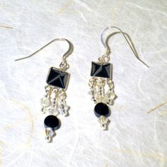 Swarovski black and crystal sterling silver earrings.  Perfect for prom night or any special occasion.