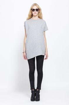 Complex Geometries Current Tee (Heather Grey) Asymmetric cotton jersey tee with draping at right side. Ribbed crew neckline. Short sleeves, extended on right side with draping under arm. Asymmetric hem, slightly longer on right side. Slips on. Hand wash. ORIGIN Canada MATERIAL 100% cotton