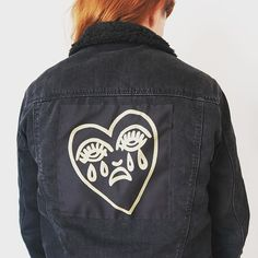 **NEW** Crying Heart back patches! Now available in my etsy shop - link in bio. Comes in Gold or White ink on black fabric #backpatch #patches #patchgame #bertgrimm #cryingheart #tattoo #oldschooltattoo #traditionaltattoo #patch #oversizepatch #screenprinted #largepatch #fabricpatch #denimjacket #patchcommand #blackjacket #punk