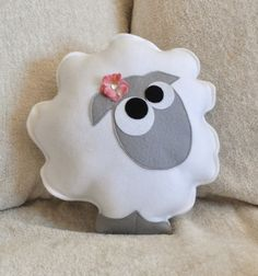 Lamb pillow- too cute! (Make with white felt and a grey head, just like shaun the sheep)