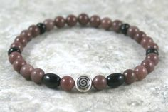 Purple aventurine stacking stretch bracelet with antique silver plated spiral accent bead and black onyx and black agate rondelles by Earthwear Collection