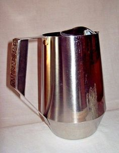 Stanley Roberts Mid Century Mod Stainless Steel VELVET Pitcher with Ice Guard #MCM #MidCentury #StanleyRoberts #StainlessSteel #kitchen