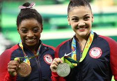 Bronze medalist Simone Biles (L) and silver medalist Lauren Hernandez (R) of the United States pose for photographs after the at the medal ceremony for  the Balance Beam on day 10 of the Rio 2016 Olympic Games at Rio Olympic Arena on August 15, 2016 in Rio de Janeiro, Brazil.