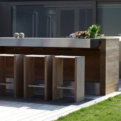 6 Outdoor Kitchens Designed To Make You Jealous: Ultra-Modern Outdoor Kitchen With No Shortage of Stainless Steel Garage, ideas, man cave, workshop, organization, organize, home, house, indoor, storage, woodwork, design, tool, mechanic, auto, shelving, car.