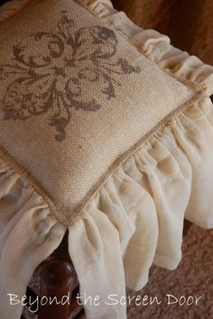 Stenciled Burlap Pillows from Beyond the Screen Door!  Love these.  Check out her shop!!!