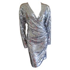 Oleg Cassini 70's silver sequin disco dress | From a collection of rare vintage evening dresses at http://www.1stdibs.com/fashion/clothing/evening-dresses/