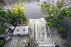 tuin tuinontwerp tuinarchitect hovenier hoveniersbedrijf tuinaanleg beplanting beplantingsplan onderhoud terras aan het water vlonderterras