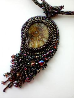 fossil pendant with fringe