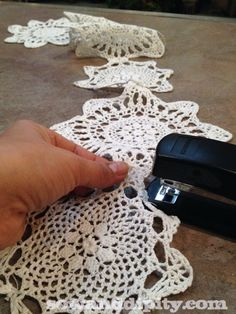 Staple small doilies together to make a lacy garland for a vintage themed tree. I think I would hand stitch together instead of staple