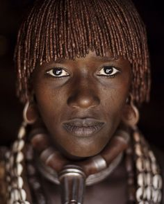 Photo by @alisonwrightphoto // This woman is from the Hamer tribe in the Omo Valley Ethiopia. It's apparent from the metal collar adornment on her neck that she's married.