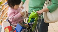 Child in shopping cart with Mom beside her