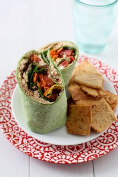 Greek Veggie Wraps (balsamic vinegar, evoo, salt, pepper, tortillas, hummus, whole wheat couscous, baby spinach leaves, diced toms or halved grape toms, julienned carrots, banana peppers, crumbled feta cheese) from Annie's Eats