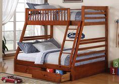 Oak finished twin over full bunk bed, features two storage drawers.