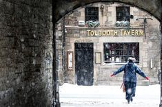 A person crosses the street in Edinburgh's Royal Mile in the snow Fine Art Prints, Framed Prints, Canvas Prints, Beast From The East, Film Images, March 1st, Pictures Of The Week, Poster Size Prints, Photo Mugs