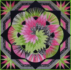 'Spiral Lone Star' by Kim Brunner / Kimmyquilt.com Made as part of a pink and green fabric challenge using a pattern from Jan Krentz' book 'Lone Star Quilts and Beyond' Embellished with hot fix Swarovski crystals and specialty threads
