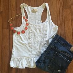 White Lace Tank Top Hollister tank top with razor back. Super cute lace detailing / embroidery down the center, and small peplum at the bottom. Size small but could fit an extra small as well. No stains, worn only a few times. Perfect for summer and spring! If you don't like the price, make an offer.  [jeans pictured are for sale in my closet!] Hollister Tops Tank Tops
