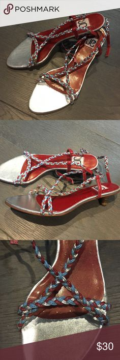 NIB Strappy kitten sandals. Excellent condition NIB Strappy Summer Sandals. Never worn new with box. Tiny chic kitten heal. Leather red, silver and light blue braided straps. Size 7 JC Shoes Sandals
