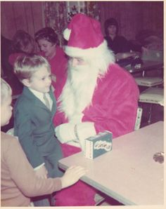 Eric Higgins sitting on Santa's lap. Eric premiered the role of Josh.
