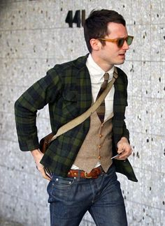 Love the tartan jacket, waste coat and tie combo, but those glasses really pull the look together.