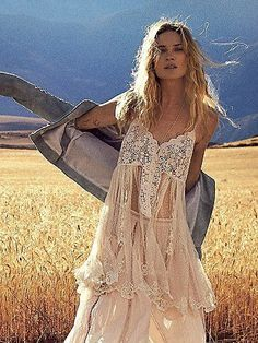 Say Hello To Heaven Slip by Free People - Dotted sheer mesh slip featuring beautiful crochet detailing along the bodice with a subtle V-neck and button closures. Allover delicate embroidery detailing with scalloped trim. Elastic band in back with adjustable ties.