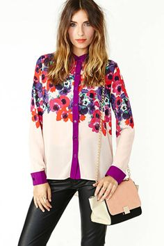 This floral Nasty Gal blouse is an absolute steal -- and on-trend for spring