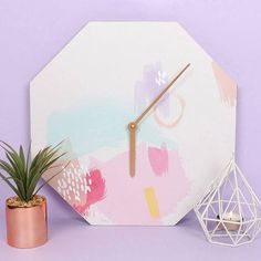 WHAT'S THE TIME? IT'S PASTEL O'CLOCK. Octogan shaped clock Measures 34cm x 34cm Made fromMDF Made in the UK
