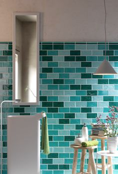 Mixed brick tiles in turquoise, aqua, and deep green give a maritime feel to the space. Bathroom Showrooms, Bathroom Interior, Bathroom Ideas, Bathrooms, Bathroom Design Inspiration, Interior Inspiration, Wall And Floor Tiles, Wall Tiles, Subway Tiles