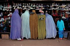 Women shoppers dressed in the tradional burqa, Kabul, Afghanistan,1992