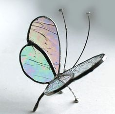 Stained Glass Sitting Butterfly - Clear Iridescence - Tabletop/Window Display. $32.50, via Etsy.