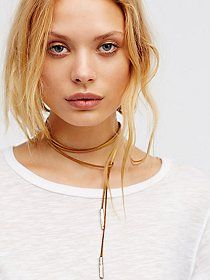 Leather Tassel Choker | Braided vegan leather choker featuring 18k gold plated loop accents and long fringe detailing. Adjustable lobster clasp closure for an easy fit.