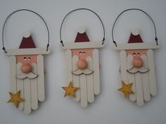 Love these wood triangle Santas with mini-popsicle stick beards.: