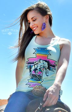 We're lovin' this new line from Crazy Train! Jump on board with our 'War Paint' racer back tank top in Mint. Such a pretty color, with a colorful serape striped cross and bucking bronco. Perfect for t