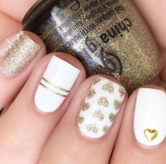 Pretty white and gold heart manicure by @melcisme using our Heart Nail Stencils found at snailvinyls.com