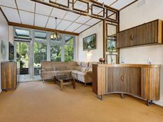 Mid Century Kew Melbourne VIC Home Dario Zoureff Jakob Rudowski Custom Cabinetry | Pinned by 360 Modern Furniture