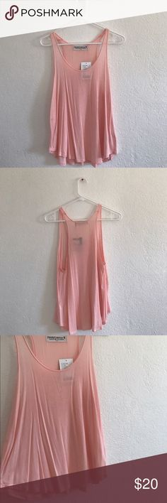 Project Social T blush tank top A cute tank top in a blush pink color. Somewhat sheer but nice for the summer! Purchased from Urban Outfitters! Urban Outfitters Tops Tank Tops
