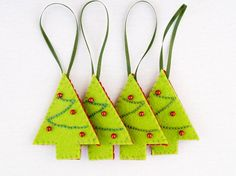 Felt embroidered Christmas trees - very simple and very lovely. The cookie cutters are going to come in very handy