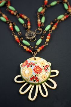 Bright Daisy Necklace by CraftyHope, via Etsy. - Beautiful use of patterns and colors!