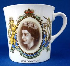 This is a Shelley China, England British royal memorabilia tea or coffee mug commemorating the coronation in 1953 of Queen Elizabeth II of England. The bone china mug measures 3 inches high by 3 in di