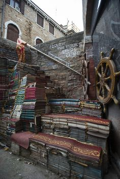 pantheonbooks:  oliviagossettisphotographer:  Book Stairs. Venice, Italy. 2013. Olivia Gossett.  Where will this lead us?