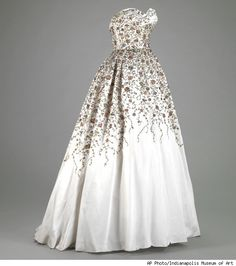 """The glamourous gown shown above, a silk ball gown embroidered with metallic threads, pearls and sequins, by French designer Pierre Balmain from his fall/winter 1953-1954 collection, is just one of the items that will be on view at the Indianapolis Museum of Art, as part of the """"Material World"""" exhibit starting on April 22."""