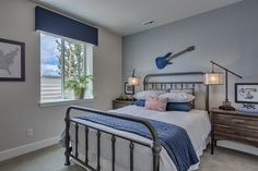 Lower level boys' bedroom with blue accent wall. #Fresco