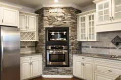 Lynchburg real estate photography virtual tours photo of a rustic kitchen with white French country style cabinets, glass windows, stacked stone. Love all the glass doors on these cabinets! But make it a double oven Kitchen Redo, Rustic Kitchen, New Kitchen, Kitchen Remodel, Kitchen Ideas, Kitchen Island, Smart Kitchen, Country Kitchen, Stone Kitchen