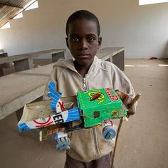 The killer toy - Virie Angola  Like in many countries, kids in south Angola can make toys with everything that they find in the street. I like the driver he made on his truck.